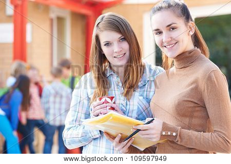 Portrait Of Two Teachers In Playground With Register