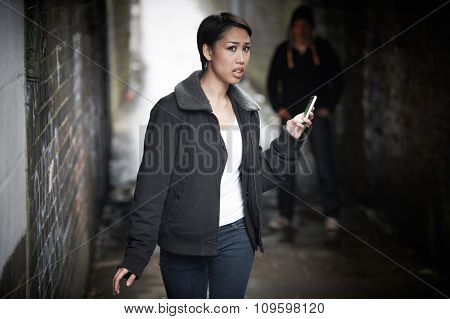 Woman Woman Walking Along City Street With Menacing Figure In Sh
