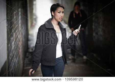 Woman Woman Walking Along City Street With Menacing Figure In Sh