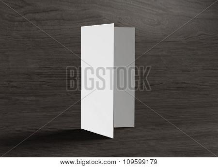 Leaflet Stand On Wood Background