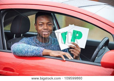 Teenage Boy Recently Passed Driving Test Holding P Plates