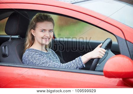 Newly Qualified Teenage Girl Driver Sitting In Car