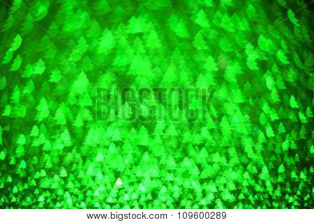 Festive Background With Christmas Tree. Abstract Twinkled Bright Background With Bokeh Defocused Lig