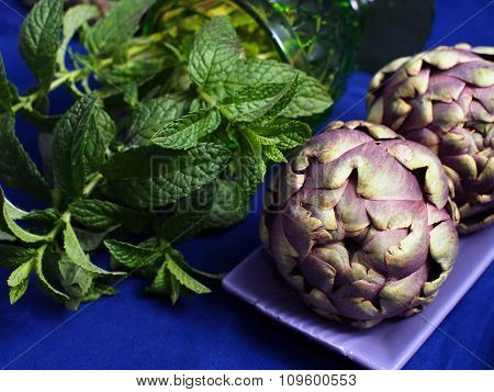 Purple globe artichokes with fresh mint