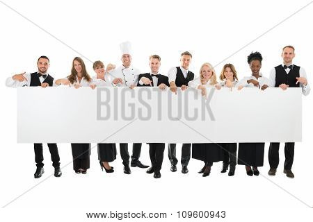 Confident Restaurant Staff Holding Blank Billboard