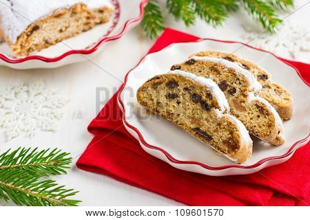 Sliced Christmas Stollen. Traditional German Christmas Cake With Dried Fruits And Icing Sugar