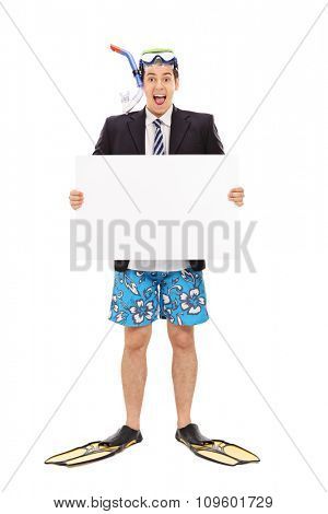 Full length portrait of an excited businessman with a snorkeling mask holding a blank banner isolated on white background