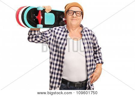Senior hipster carrying a skateboard over his shoulder and looking at the camera isolated on white background