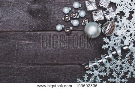 Silver Christmas decoration on wooden vintage background. Gift box and balls.