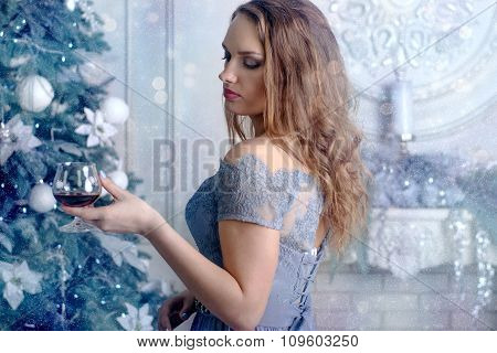 Woman Holds A Glass Of Brandy