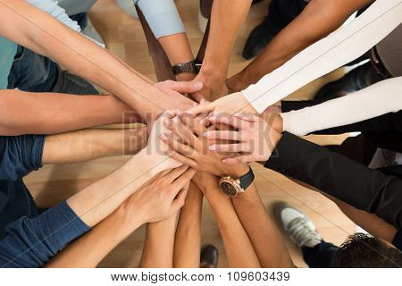 Creative Business People Piling Hands Over White Background
