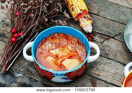 Traditional Ukrainian Russian vegetable borscht on the old wooden background. Ukrainian and russian