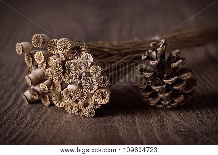 Boquet Dry Poppy Head And Pine Cone On A Wooden Background