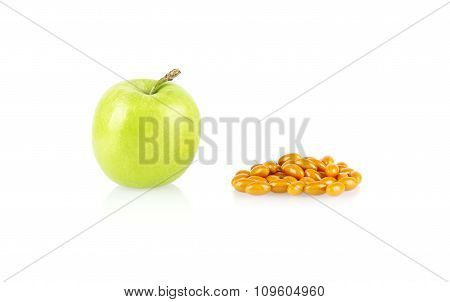 Green Apple And Medical Tablets Isolated