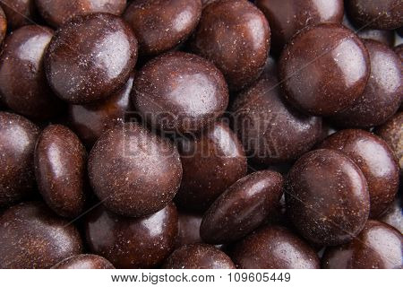Close Up On Pile Brown Milk Chocolate Candies Crisp Shell