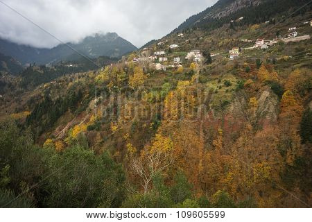 Scenic Mountain Autumn Landscape And Village Prusos