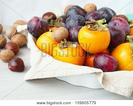 Colorful fruit still life with chestnuts
