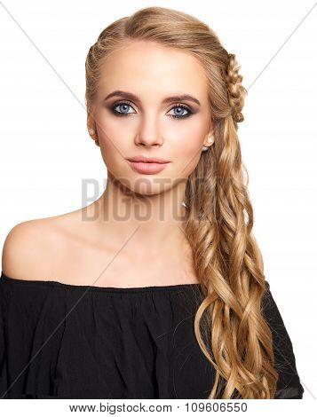 portrait of a beautiful young blonde woman on a light background with hairdo on her head. copy space