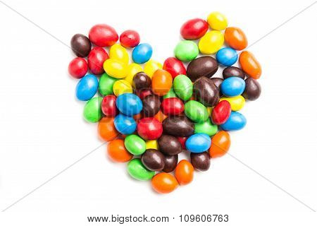 Heart Shape With Colorful Milk Chocolate Candies On White Background
