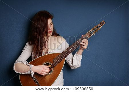 woman playing lute instrument