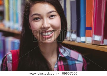 Smiling student in library at the university