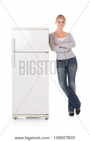 Woman Leaning On Refrigerator Over White Background