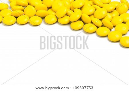 Top Right Frame Of Yellow Chocolate Candy On White Background