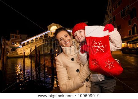 Happy Mother And Daughter Showing Christmas Sock In Venice