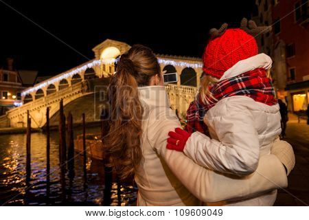 Seen From Behind, Mother And Daughter Looking On Rialto Bridge