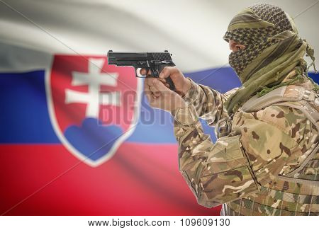 Male In Muslim Keffiyeh With Gun In Hand And National Flag On Background - Slovakia