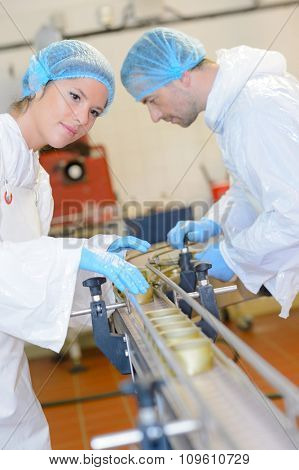 Male and female workers on production line