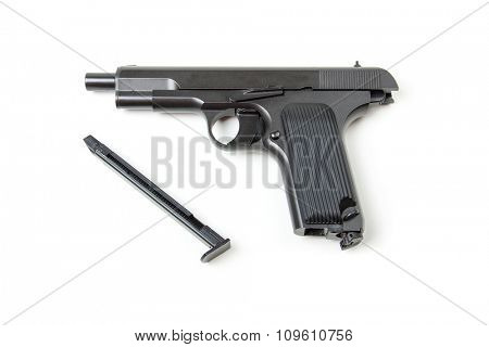 Isolated disassembled gun on white background