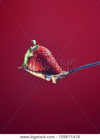 Strawberry Falling A Little Chocolate Liquid