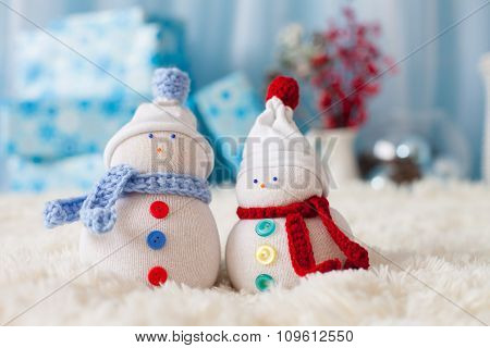 Two Handmade Snowmen With Christmas Background On White Fur