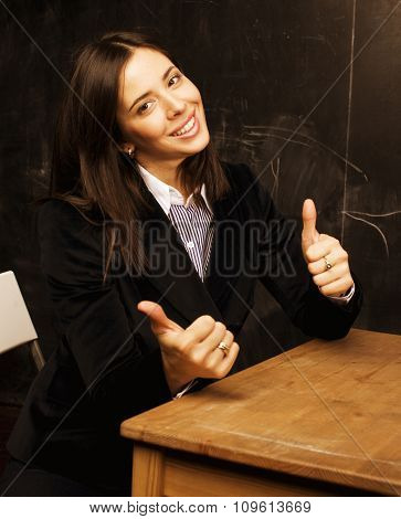 portrait of happy cute student in classroom at blackboard back to school