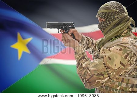 Male In Muslim Keffiyeh With Gun In Hand And National Flag On Background - South Sudan