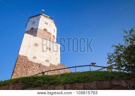 Main Tower Of Vyborg Castle With Tourists On Roof