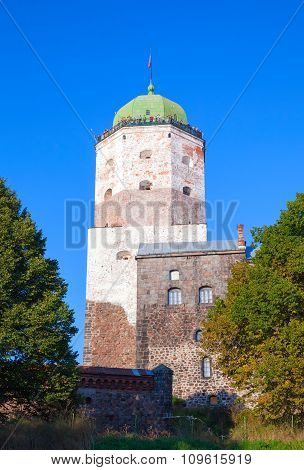 Vyborg Castle With Tourists On Observation Deck