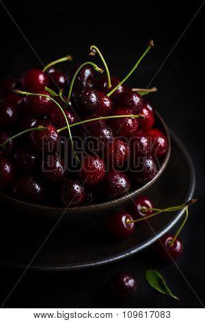 Fresh Cherries In Black Bowl