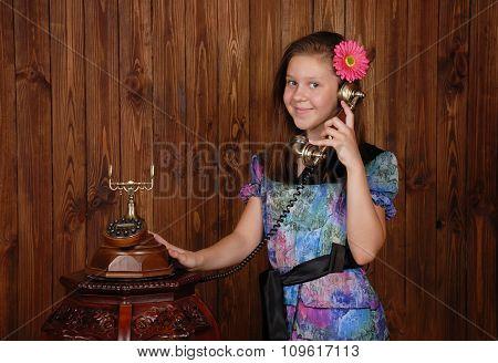 Girl speaks by retro phone