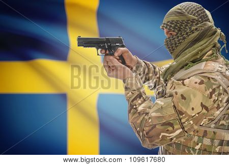 Male In Muslim Keffiyeh With Gun In Hand And National Flag On Background - Sweden