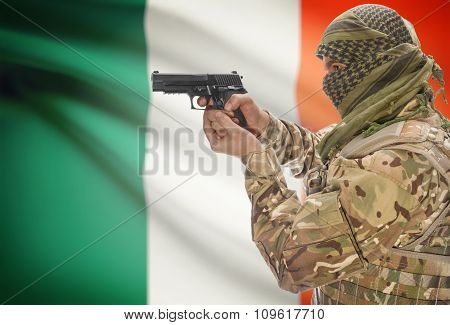Male In Muslim Keffiyeh With Gun In Hand And National Flag On Background - Ireland