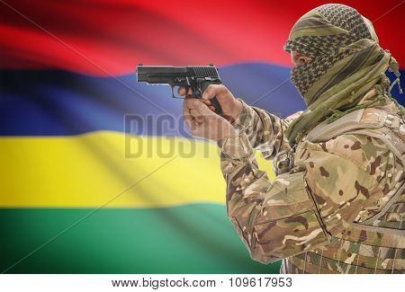 Male In Muslim Keffiyeh With Gun In Hand And National Flag On Background - Mauritius