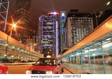 Hong Kong, China - July 14, 2007: Taxi station and night view of the HSBC