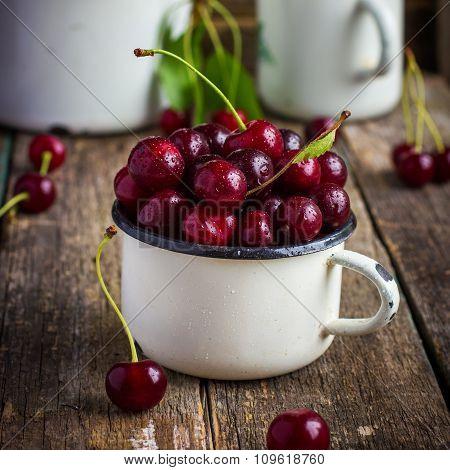 Fresh Cherries In Enamel Mug