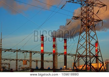 Industrial Landscape And Pipes With A Smoke Against The Background Of The Sky