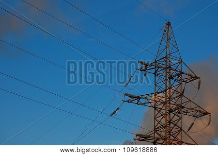 High-voltage Power Line Against The Background Of The Sky