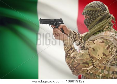 Male In Muslim Keffiyeh With Gun In Hand And National Flag On Background - Italy