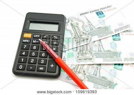 Calculator, Banknotes And Red Pen