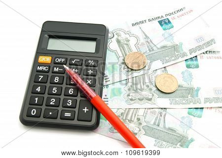 Banknotes, Calculator And Red Pen
